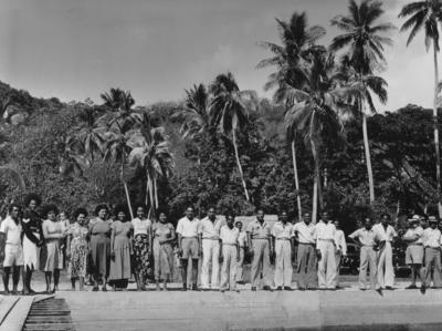 Photograph of a line of 22 people on a beach in Fiji