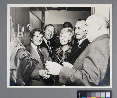 [Sir Geoffrey Roberts and other unidentified figures at the Bank Settlement Plan office opening]