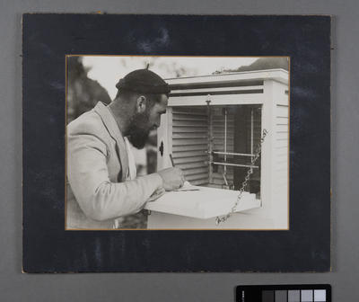 [Meteorologist William 'Bill' Scarborough at an instrument shelter in Jackson Bay]