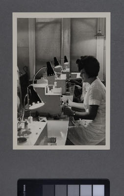 [Hirst Contact Lens laboratory technician at work station]