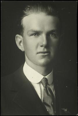 Black and white studio portrait of Alex Campbell Craig