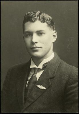 Black and white studio portrait of Henry Lovell White