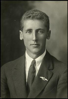 Black and white studio portrait of Douglas Grey George
