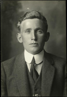 Black and white studio portrait of William Wallace Cook