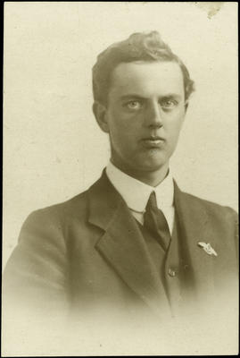 Black and white studio portrait of Arthur Francis Tasker