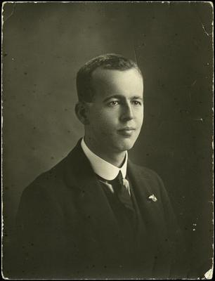 Black and white studio portrait of Eric Norman Strain