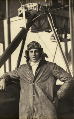 """[Graduate of the New Zealand Flying School, Frederick Stanley Gordon, wearing pilot's clothing standing by a Walsh Flying boat """"D""""]"""