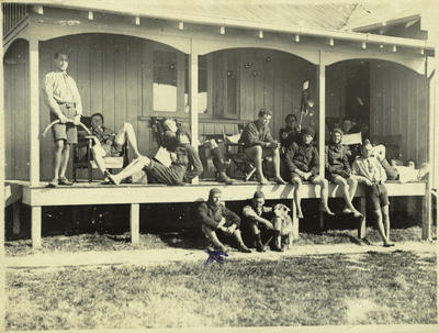 Black and white photograph of Walsh Brothers Flying School pilots on the verandah of the recreation hut at the school
