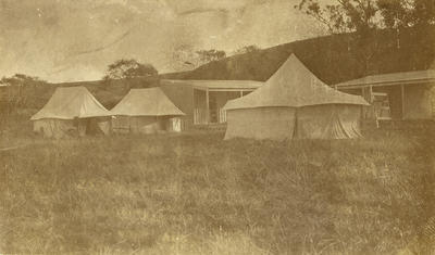 Black and white photograph of tents and buildings of the Walsh Brothers Flying School