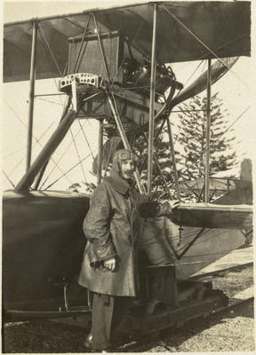 Black and white photograph of Marmaduke Matthews in pilot's garb, Curtiss flying boat at Mission Bay