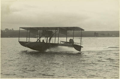 Black and white photograph of Walsh Brothers Flying School Curtiss flying boat either taking off or landing