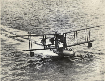 Black and white photograph of the Walsh Brothers Flying School's Supermarine Channel Flying Boat, planing at high speed