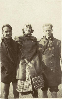 Black and white photograph of George Bolt, right, Harry Carter, left carrying a female passenger ashore