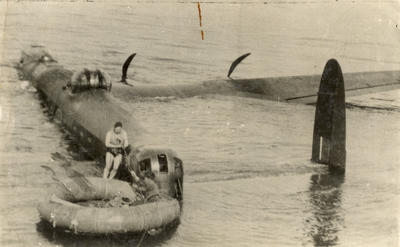 [Avro Lancaster Mark I W4318 and airmen of No. 103 Squadron in English Channel]