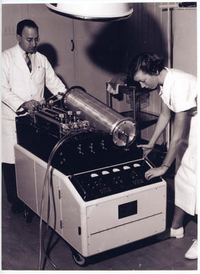 Photograph of the Melrose heart-lung machine with Syd Yarrow and nurse Shona Budd demonstrating it