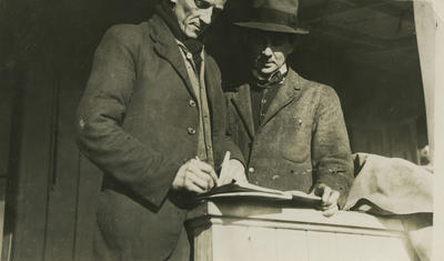 Photograph of George Bolt with another man wearing a hat.