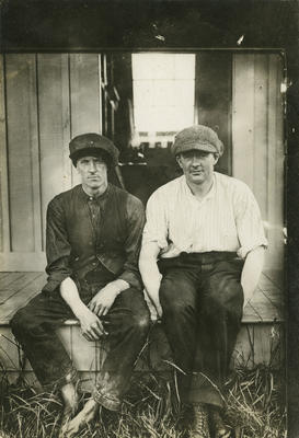 Photograph of George Bolt sitting with another man on the edge of a porch