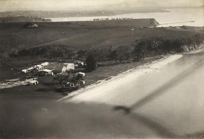 [New Zealand Flying School hangars and camp taken from the air looking North]