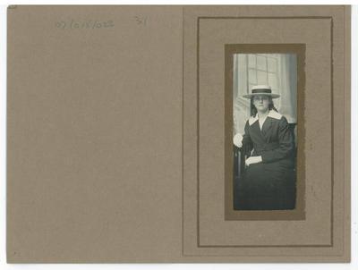 Studio portrait of a seated teenage girl in school uniform