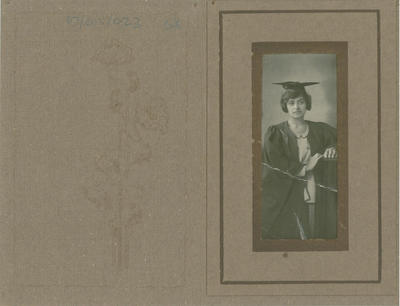 Studio portrait of a woman wearing a graduation gown and cap; <C> Everybody's Studio; [1930s-1940s]