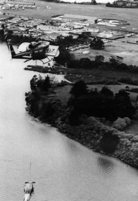 RNZAF helicopter transporting NZ 1707 Auster aircraft after it crashed in Kaipara Harbour