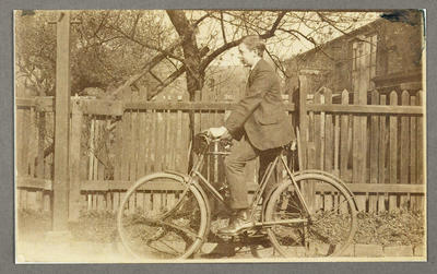 [Copy photograph of Oscar Garden on bicycle in Manchester]