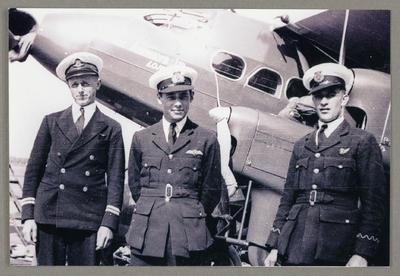 [Copy photograph of three British Airways staff]