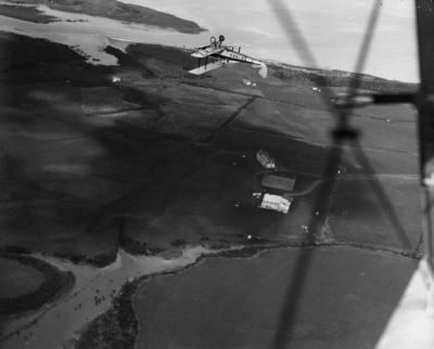 Photograph of Auckland Aero Club member D.M.Allan stunting in ZK-AAU.