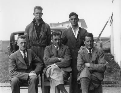 Photograph of Auckland Aero Club members A. McGruer, D.Wood, Len Swan Secretary,D.M. Allan,  Tereanor caterer, 1930's.