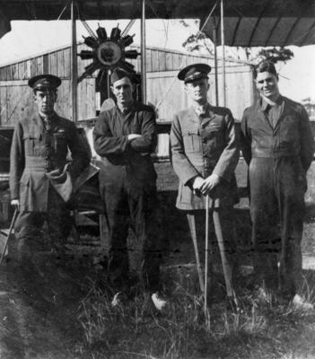 """New Zealand Flying School trainees in front of Walsh Brothers solo flying boat """"E"""" at Kohimarama"""
