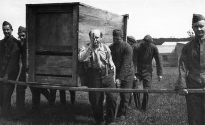 New Zealand Flying School, trainees carrying crate at Kohimarama