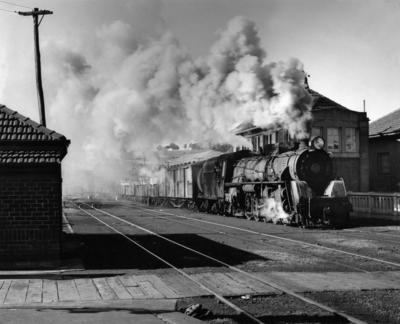 Locomotive J 1236 with mixed goods train, Auckland central rail yards, 1953