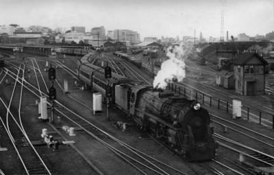 Locomotive K 909 leaving Auckland central station with passenger train, c 1954