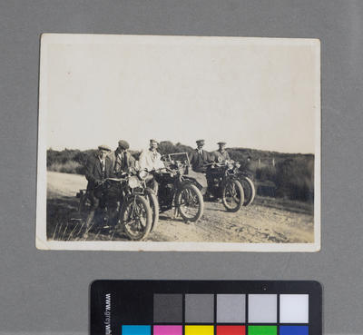 [Group of unidentified males on motorcycles]