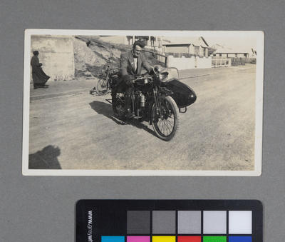 [Frederick Raynor Pinny on Indian motorcycle sidecar combination]