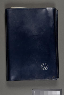 [Owner's document wallet and record for Deluxe Saloon Volksagen Beetle]
