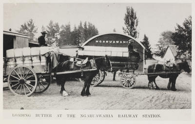 Milk floats loading out butter at Ngaruawahia railway station