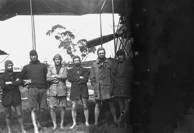 [New Zealand Flying School trainees beside seaplane]