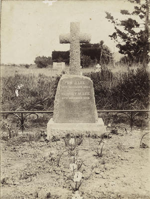 Photograph of a gravesite with headstone