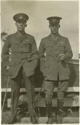 [Negative of Walsh Brothers Flying School graduate Henry (Harry) Melhuish Carter and another man in NZFS uniform]