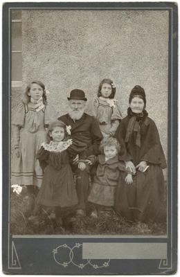 Group photograph of an elderly couple with four children