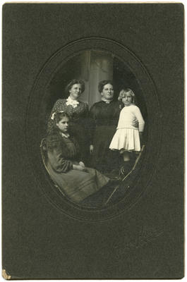 Photograph of two women and two children