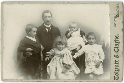 Photograph of a man with four children