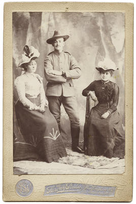 Photograph of a man and a woman and a young woman