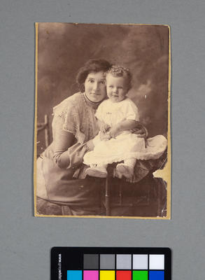 [Black and white studio portrait of a woman and child]