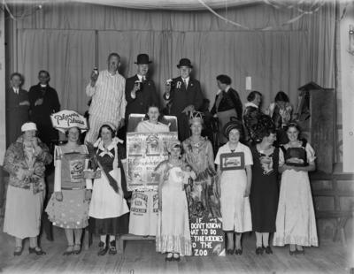 Photograph of people dressed in costume