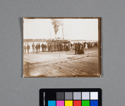 [Photograph of coal ship and crowds]