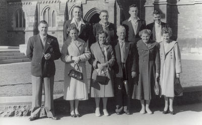 [Unidentified group of Auckland tramway cricket players and supporters in front of Christchurch Cathedral]; Ascot Photographers; Feb 1948