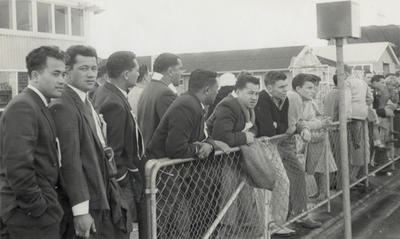 [Unidentified cricket team supporters at grounds]; Unknown Photographer; Feb 1948?