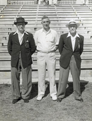 [Unidentified cricket player and two officials]